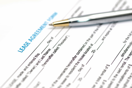 Lease form with pen laying across the form